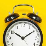 Black Retro Alarm Clark on Yellow Background